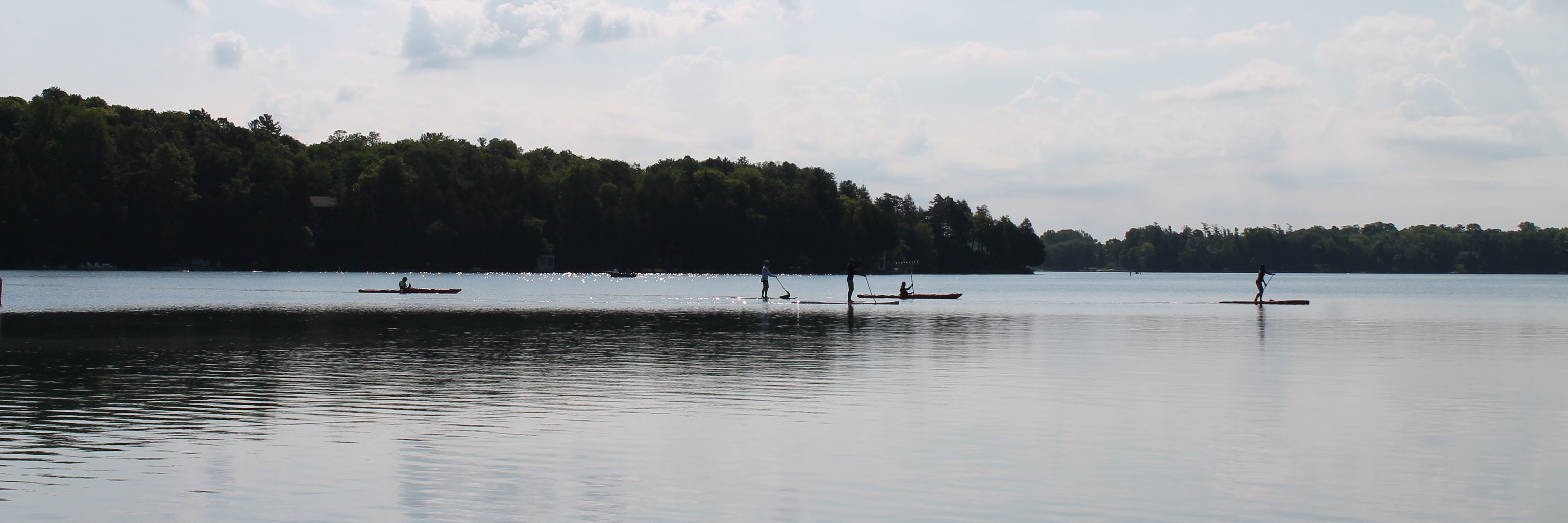 students paddle boarding on Elkhart Lake